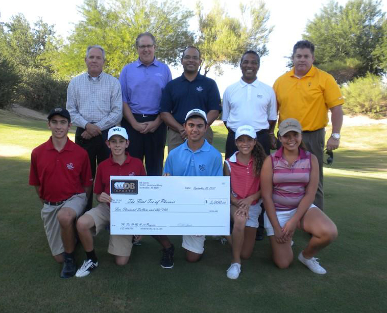 OB Sports First Tee of Phoenix Donation - Photo: From Left To Right - Bottom Row: First Tee of Phoenix Participants: Christian David, James David, Timmy Briones, MaryAnna Jones, Catherine Jones, Top Row: Bret Greenwood, General Manager at Eagle Mountain; Jay Larscheid, General Manager at Longbow; Hugh Smith, Executive Director of First Tee of Phx; Derek Crawford, General Manager at Raven GC Phx; Joey Jones, Head Golf Professional at ASU Karsten